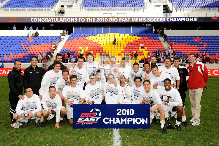 The Louisville Cardinals pose for photos with the team trophy. The Louisville Cardinals defeated the Providence Friars 3-2 in penalty kicks after playing to a 1-1 tie during the finals of the Big East Men's Soccer Championship at Red Bull Arena in Harrison, NJ, on November 14, 2010.