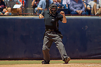 Home plate umpire Ryan Morehead makes a third strike call during the game between the University of Washington Huskies and the Cal State Fullerton Titans at Goodwin Field on June 08, 2018 in Fullerton, California. The University of Washington Huskies defeated the Cal State Fullerton Titans 8-5. (Donn Parris/Four Seam Images)