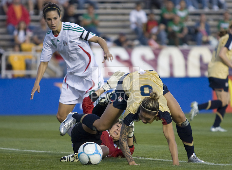 USA's Natasha Kai and Mexico Goalie, Sophia Perez battle for the ball in front of the goal..International friendly, USA Women vs Mexico, Albuquerque, NM,.October 20, 2006..USA 1, Mexico 1.