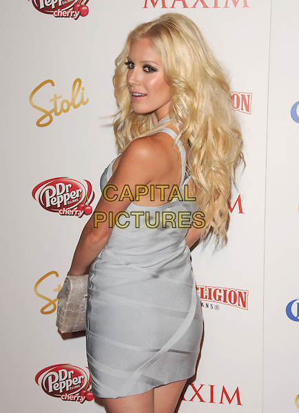 HEIDI MONTAG.The Maxim's Hot 100 List Party held at Barker Hangar in Santa Monica, California on .May 13th, 2009.half length grey gray silver blue dress clutch bag  looking over shoulder .CAP/DVS.©Debbie VanStory/Capital Pictures.