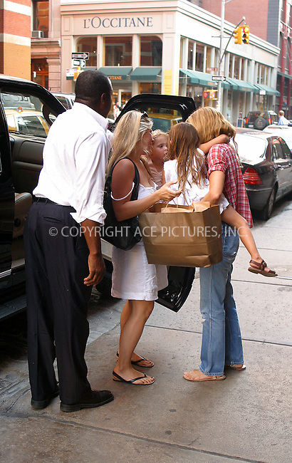 WWW.ACEPIXS.COM . . . . .  ....NEW YORK, JULY 26, 2005....Kate Moss picks up daughter Lila Grace and carries her on her hip through SoHo.....Please byline: PAUL CUNNINGHAM - ACE PICTURES..... *** ***..Ace Pictures, Inc:  ..Craig Ashby (212) 243-8787..e-mail: picturedesk@acepixs.com..web: http://www.acepixs.com