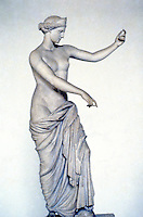 Greek Art:  Aphrodite of Capua--copy of 4th C. B.C. original.  The Goddess looks at herself in the shield of Ares.  National Museum, Naples.  Photo '83.