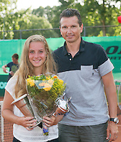 August 9, 2014, Netherlands, Rotterdam, TV Victoria, Tennis, National Junior Championships, NJK,  Prize giving, Richard Krajicek with Inger van Dijkman, winner girls 18 years<br /> Photo: Tennisimages/Henk Koster
