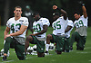 Julian Howsare #43, left, and teammates stretch during New York Jets Training Camp at the Atlantic Health Jets Training Center in Florham Park, NJ on Thursday, Aug. 10, 2017.