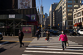 New York, New York<br /> March 18, 2020<br /> 9:48 AM<br /> <br /> Manhattan under coronavirus pandemic. People walk with face masks fearing catching the virus.