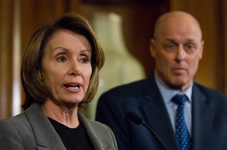 """WASHINGTON, DC - Jan. 24: House Speaker Nancy Pelosi, D-Calif., and Treasury Secretary Henry M. Paulson Jr. during a news conference with House Minority Leader John A. Boehner, R-Ohio, announcing that House leaders and the Bush administration reached a compromise economic stimulus package Thursday built around rebates for most taxpayers and incentives for business investment. The measure, estimated at $150 billion, also would make it easier for homeowners to refinance their adjustable-rate mortgage loans into fixed-rate mortgages insured by the Federal Housing Administration. House Speaker Nancy Pelosi, D-Calif., and Minority Leader John A. Boehner, R-Ohio, called on members of their respective caucuses to line up behind the package so it can quickly be passed by the House and sent to the Senate. President Bush added his encouragement. """"Because the country needs this boost to the economy now, I urge the House and the Senate to enact this economic growth agreement into law as soon as possible,"""" he said. (Photo by Scott J. Ferrell/Congressional Quarterly)"""