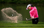 Yanyan Hu of China hits her shot during the Hyundai China Ladies Open 2014 on December 12 2014 at Mission Hills Shenzhen, in Shenzhen, China. Photo by Li Man Yuen / Power Sport Images