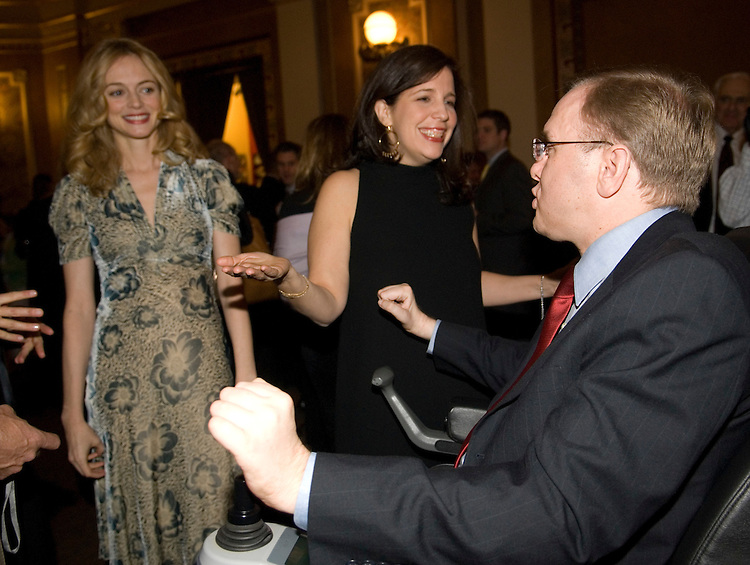 From left, Heather Graham, star of the movie 'Gray Matters' and director Sue Kramer speak with Rep. Jim Langevin, D-R.I., during the 'Tribute to the 110th Congress' sponsored by the Creative Coaltion at B. Smith's restaurant in Washington on Wednesday night, Jan. 31, 2007.