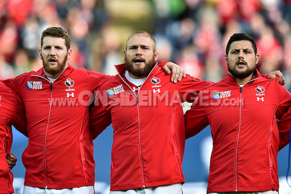 Kyle Gilmour, Jake Ilnicki and Benoit Piffero of Canada sing their national anthem prior to the match. Rugby World Cup Pool D match between Canada and Romania on October 6, 2015 at Leicester City Stadium in Leicester, England. Photo by: Patrick Khachfe / Onside Images