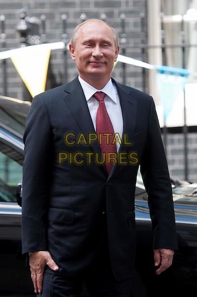 Vladimir Putin.Russian president, Vladimir Putin, at No.10 Downing Street to hold talks with Prime Minister David Cameron, London, England..August 2nd, 2012.politics half length black suit tie red .CAP/BF.©Bob Fidgeon/Capital Pictures.