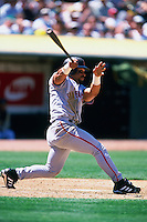 OAKLAND, CA - Marvin Benard of the San Francisco Giants bats during a game against the Oakland Athletics at the Oakland Coliseum in Oakland, California in 2000. Photo by Brad Mangin