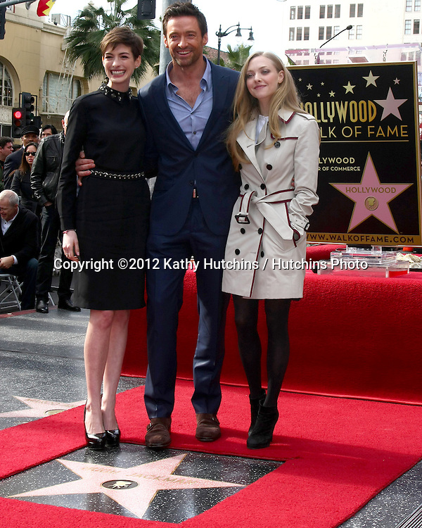 LOS ANGELES - DEC 13:  Anne Hathaway, Hugh Jackman, Amanda Seyfried at the Hollywood Walk of Fame ceremony for Hugh Jackman at Hollywood Boulevard on December 13, 2012 in Los Angeles, CA