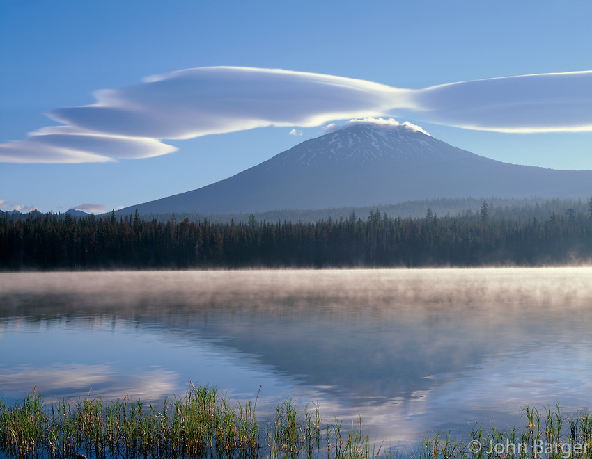 ORCAC_058 - USA, Oregon, Deschutes National Forest, Lenticular cloud and Mount Bachelor reflect in misty, water of Little Lava Lake in early morning.