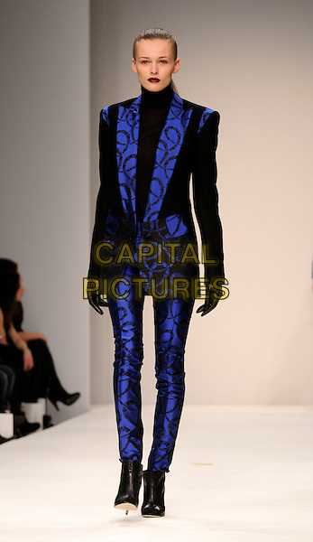 MODEL.The Jens Laugesen LFW catwalk show, BFC Tent, London, England. .February 13th, 2008.London Fashion Week full length black boots jacket trousers gloves  pattern .CAP/CAN.©Can Nguyen/Capital Pictures.