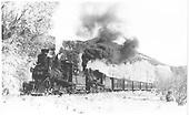RGS 2-8-0 #42 and K-27 #455 double-heading stock cars northbound out of Placerville.<br /> RGS  Placerville, CO  Taken by Perry, Otto C. - 10/24/1940