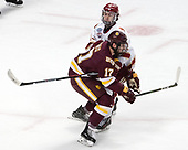 Liam Finlay (DU - 13), Blake Young (UMD - 17) - The University of Denver Pioneers defeated the University of Minnesota Duluth Bulldogs 3-2 to win the national championship on Saturday, April 8, 2017, at the United Center in Chicago, Illinois.