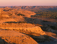 NDTR_115 - USA, North Dakota, Theodore Roosevelt National Park, Evening light on sedimentary hills and valley of the Little Missouri River, view east from River Bend Overlook, North Unit