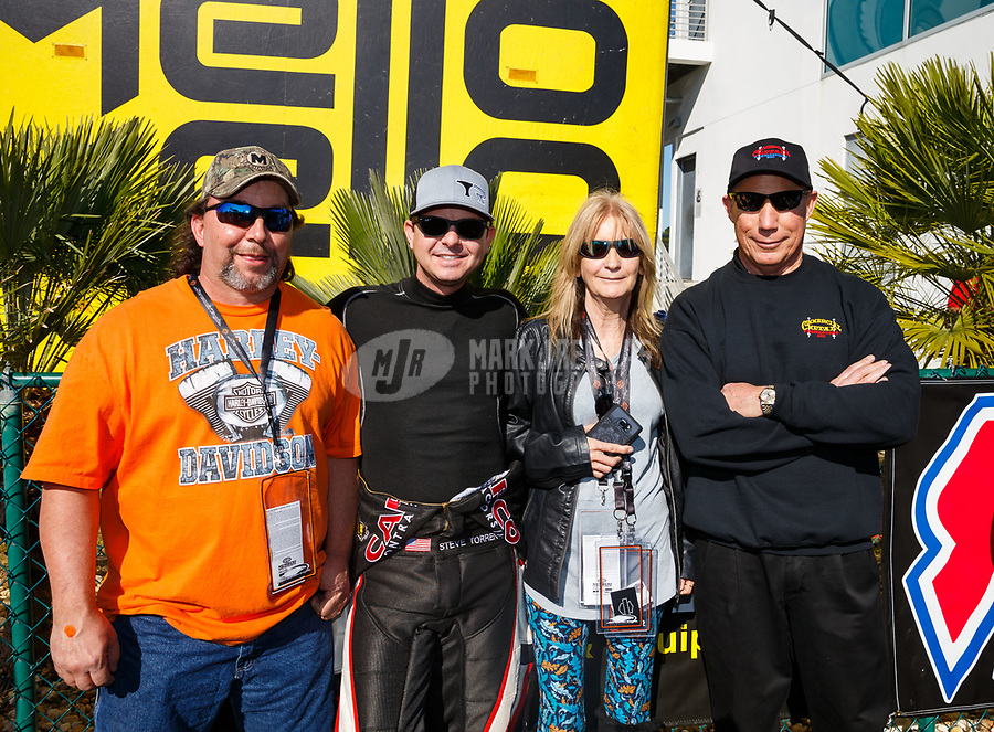 Mar 19, 2017; Gainesville , FL, USA; NHRA top fuel driver Steve Torrence (left) and Pat Dakin with VIP guests during the Gatornationals at Gainesville Raceway. Mandatory Credit: Mark J. Rebilas-USA TODAY Sports