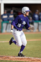 Carson Jackson (10) of the High Point Panthers hustles down the first base line against the UNCG Spartans at Willard Stadium on February 14, 2015 in High Point, North Carolina.  The Panthers defeated the Spartans 12-2.  (Brian Westerholt/Four Seam Images)