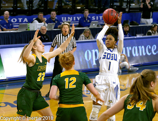 BROOKINGS, SD - JANUARY 6: Alexis Alexander #1 from South Dakota State University spots up for a jumper over Michelle Gaislerova #22 and Sarah Jacobson #12 from North Dakota State University  during their game Saturday afternoon at Frost Arena in Brookings, SD. (Photo by Dave Eggen/Inertia)