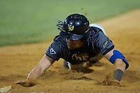 Sam Frontino (32) (University of Pittsburgh) of the Wilson Tobs dives back towards first base during the game against the High Point-Thomasville HiToms at Finch Field on July 17, 2020 in Thomasville, NC. The Tobs defeated the HiToms 2-1. (Brian Westerholt/Four Seam Images)