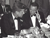 United States Senator John F. Kennedy (Democrat of Massachusetts), left, and entertainer Frank Sinatra, right, at the black tie Democratic Committee Dinner at the Beverly Hilton Hotel in Los Angeles, California on Sunday, July 10, 1960.<br />