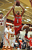 Tyiquon Nix #1 of Center Moriches, right, drives to the net as Julian Kleisler #24 of Babylon challenges his shot during a Suffolk County League VII varsity boys basketball game at Babylon High School on Friday, Jan. 26, 2018. Center Moriches won by a score of 84-80.