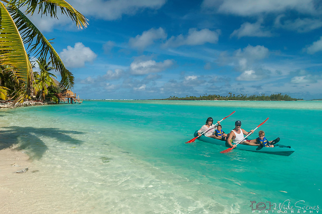 Family enjoying a canoe ride at Aitutaki Lagoon Resort & Spa on Aitutaki, Cook Islands