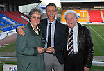 St Johnstone Player of the Year Awards 2014-15.....16.05.15<br /> Fiona Davidson and John Shaw present the McDiarmid Park Supporter's Bus Player of the Year Award to Chris Millar<br /> Picture by Graeme Hart.<br /> Copyright Perthshire Picture Agency<br /> Tel: 01738 623350  Mobile: 07990 594431