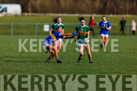 Ella Teahan of Kerry about to shoot despite the  challenge from Carrie Davey of Tipperary in R1 of the MLGFA Minor A Football Championship in John Mitchels GAA Complex on Sunday