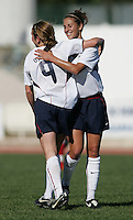 MAR 11, 2006: Quarteira, Portugal:  USWNT forward (9) Heather O'Reilly is congratulated by teammate (11) Carli Lloyd on her goal while playing Denmark in the Algarve Cup in Quarteira, Portugal.