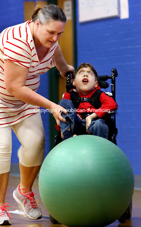 NORTH CANAAN CT. 10 March 2016-031016SV05- Betty Swiderski, Special Ed Paraprofessional, helps Walter Hayward, 11, with gym class at North Canaan Elementary School in North Canaan Thursday.<br /> Steven Valenti Republican-American