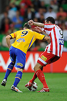MELBOURNE, AUSTRALIA - JANUARY 09: Shane Smeltz of United and Gerald Sibon of the Heart compete for the ball during the round 23 A-League match between the Melbourne Heart and Gold Coast United at AAMI Park on January 19, 2011 in Melbourne, Australia. (Photo by Sydney Low / Asterisk Images)