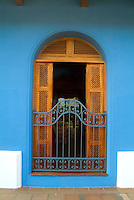Window with wooden shutters in a Colonial Buliding in Granada, Nicaragua.