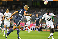 Melbourne, December 1, 2018 - Keisuke Honda of Melbourne Victory heads a goal in the round six match of the A-League between Melbourne Victory and Western Sydney Wanderers at Marvel Stadium, Melbourne, Australia.