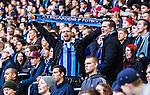 Stockholm 2014-04-06 Fotboll Allsvenskan Djurg&aring;rdens IF - Halmstads BK :  <br /> Djurg&aring;rden supporter med en halsduk<br /> (Foto: Kenta J&ouml;nsson) Nyckelord:  Djurg&aring;rden DIF Tele2 Arena Halmstad HBK supporter fans publik supporters