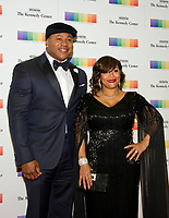 LL COOL J and his wife, Simone Smith, arrive for the formal Artist's Dinner honoring the recipients of the 40th Annual Kennedy Center Honors hosted by United States Secretary of State Rex Tillerson at the US Department of State in Washington, D.C. on Saturday, December 2, 2017. The 2017 honorees are: American dancer and choreographer Carmen de Lavallade; Cuban American singer-songwriter and actress Gloria Estefan; American hip hop artist and entertainment icon LL COOL J; American television writer and producer Norman Lear; and American musician and record producer Lionel Richie. Photo Credit: Ron Sachs/CNP/AdMedia