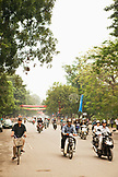 VIETNAM, Hanoi, traffic buzzes on the avenue that circumnavigates Hoan Kiem Lake, Dinh Tien Hoang street