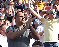 Leeds United fans celebrate their teams 3-0 win<br /> <br /> Photographer Stephen White/CameraSport<br /> <br /> The Premier League - Stoke City v Leeds United - Saturday August 24th 2019 - bet365 Stadium - Stoke-on-Trent<br /> <br /> World Copyright © 2019 CameraSport. All rights reserved. 43 Linden Ave. Countesthorpe. Leicester. England. LE8 5PG - Tel: +44 (0) 116 277 4147 - admin@camerasport.com - www.camerasport.com