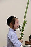 Israel, Bnei Brak. Succot holiday at the Premishlan congregation. A boy with the Four Species<br />