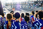 The leader give the last instructions before his dozens of dancers perform in Susukino district, Sapporo