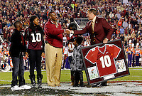 TALLAHASSEE, FL 11/13/10-FSU-CLEMSON FB10 CH-Former Florida State football star Derrick Brooks shakes hands with Athletic Director Randy Spetman as he is honored for his play with the Seminoles during a jersey retirement ceremony at half time of the Clemson game Saturday at Doak Campbell Stadium in Tallahassee. .COLIN HACKLEY PHOTO