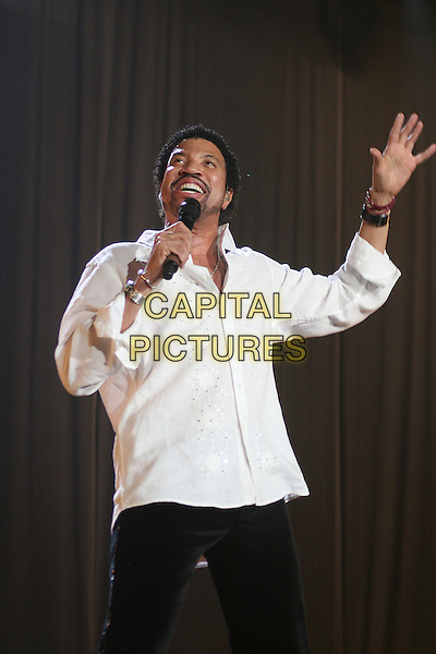 LIONEL RICHIE.Live in concert at the Wembley Arena, London, England..March 23rd, 2007 .stage concert gig performance music half length white shirt goatee facial hair singing hand.CAP/MAR.© Martin Harris/Capital Pictures.