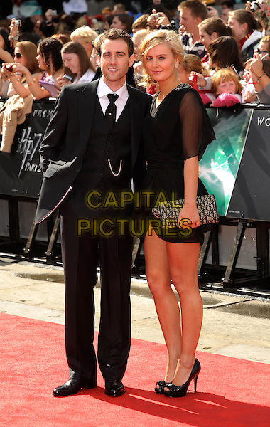 Matt Lewis & guest.'Harry Potter and the Deathly Hallows - Part 2' world film premiere arrivals Trafalgar Square, London, England 7th July 2011.HP7 full length black suit dress.CAP/DH.©David Hitchens/Capital Pictures.
