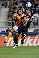 Brian Ching (25) of the Houston Dynamo and Sheanon Williams (25) of the Philadelphia Union go up for a header. The Philadelphia Union and the Houston Dynamo played to a 1-1 tie during a Major League Soccer (MLS) match at PPL Park in Chester, PA, on August 6, 2011.
