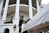 A member of the National Park Service cleans an awning prior to an arrival ceremony for President Lee Myung-bak of South Korea on the South Lawn at the White House in Washington, D.C. on Thursday, October 13, 2011. .Credit: Kevin Dietsch / Pool via CNP