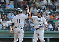 Catcher Gary Sanchez (35) of the Charleston RiverDogs is congratulated by Tyler Austin (11) after hitting a home run in a game against the Greenville Drive on June 2, 2012, at Fluor Field at the West End in Greenville, South Carolina. Greenville won, 10-4. Sanchez is the Yankees' No. 4 prospect, according to Baseball America. (Tom Priddy/Four Seam Images)