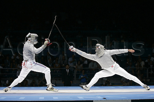 19 August 2004:  French Fencer JULIEN PILLET (FRA) (L) v GIANPIERO PASTORE (ITA) (R) during the Men's Team Sabre Medal Matches Gold Medal Match, ITA v FRA. Helliniko Olympic Complex Fencing Hall, 2004 Olympic Games, Athens, Greece. Photo: Neil TingleAction Plus....040819 olympics..