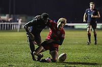 Matt Williams of London Scottish is tackled during the Greene King IPA Championship match between London Scottish Football Club and Jersey Reds at Richmond Athletic Ground, Richmond, United Kingdom on 16 March 2018. Photo by David Horn.