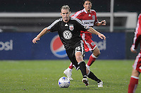 DC United defender Bryan Namoff (26) dribbles the ball, Chicago Fire tied DC United 1-1at  RFK Stadium, Saturday March 28, 2009.